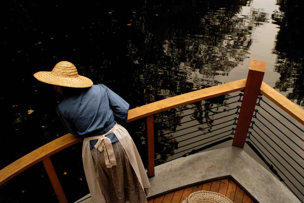 woman with straw hat on c&o Canal packet boat.