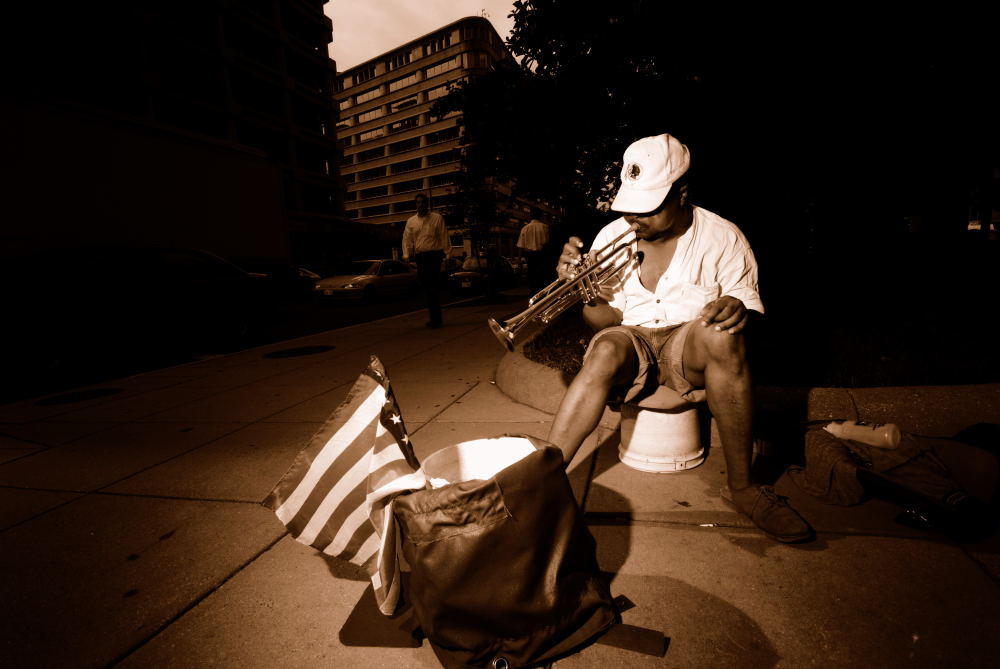 Street musician, downtown Washington DC. Trumpet and American flag.