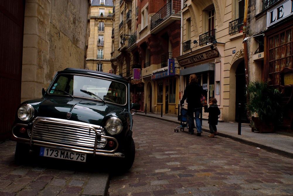 Mini Cooper on the old brick streets of Paris.