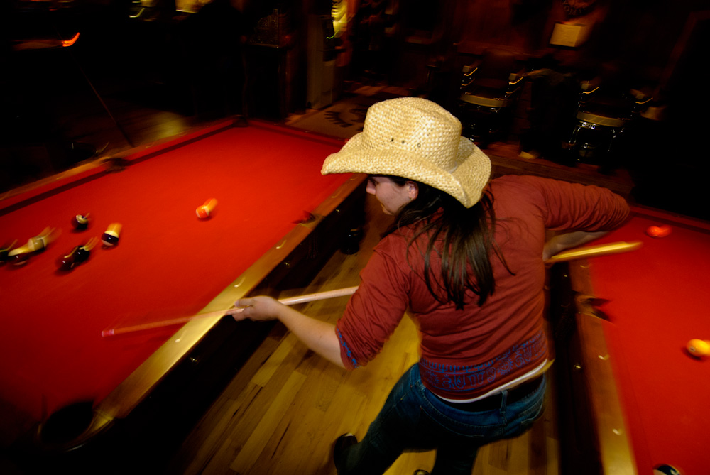 Cowgirl shooting pool in Jackson bar. Jackson, wyoming.