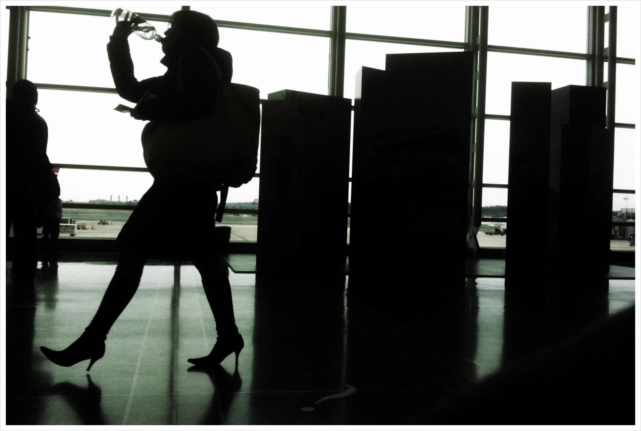 woman drinking water at national airport, whashington DC