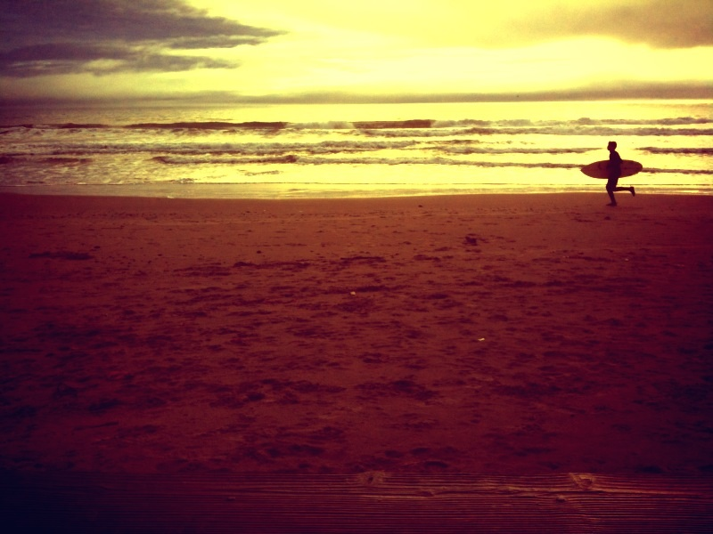 Surfer at Stinson Beach, California.