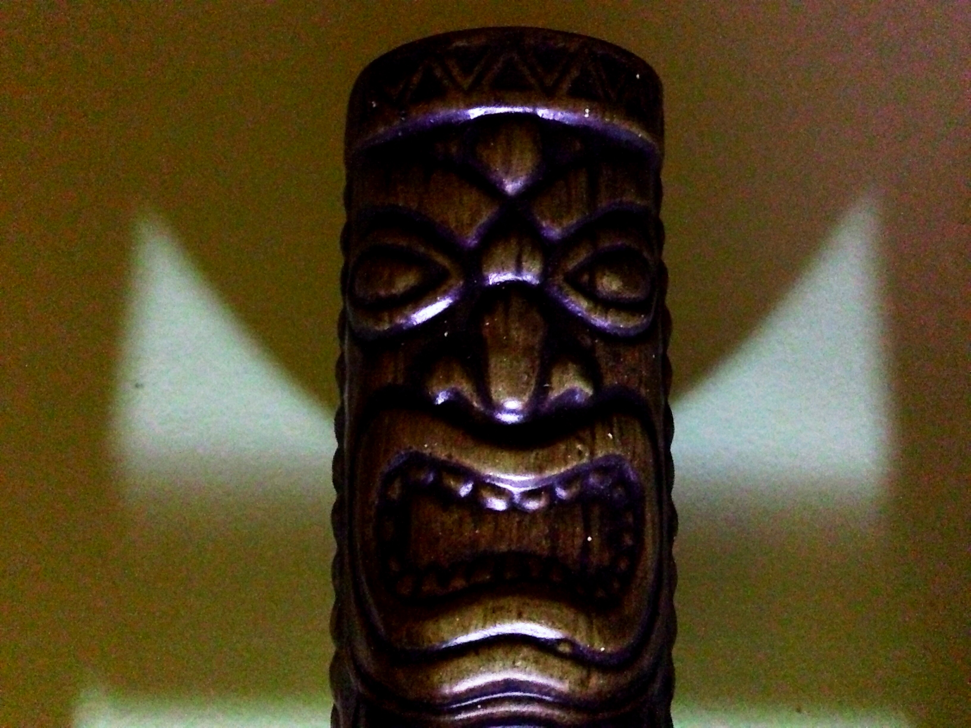 Tiki idol cup. Lit with flashlight, shot with iPhone 5.