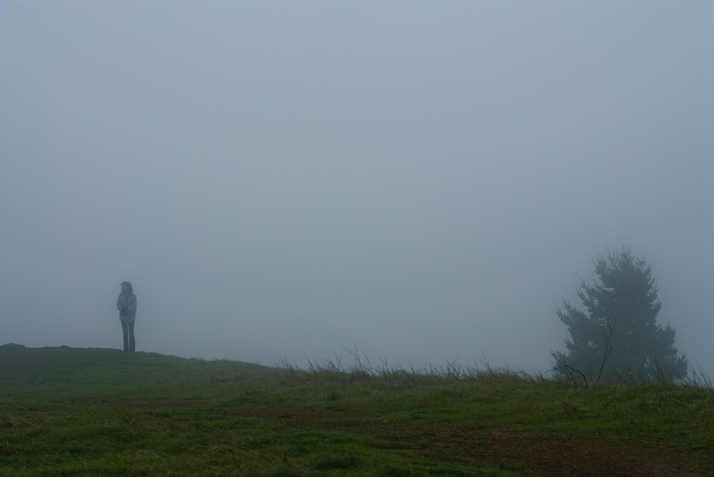 Woman standing in the fog. Mount Tamalpais.