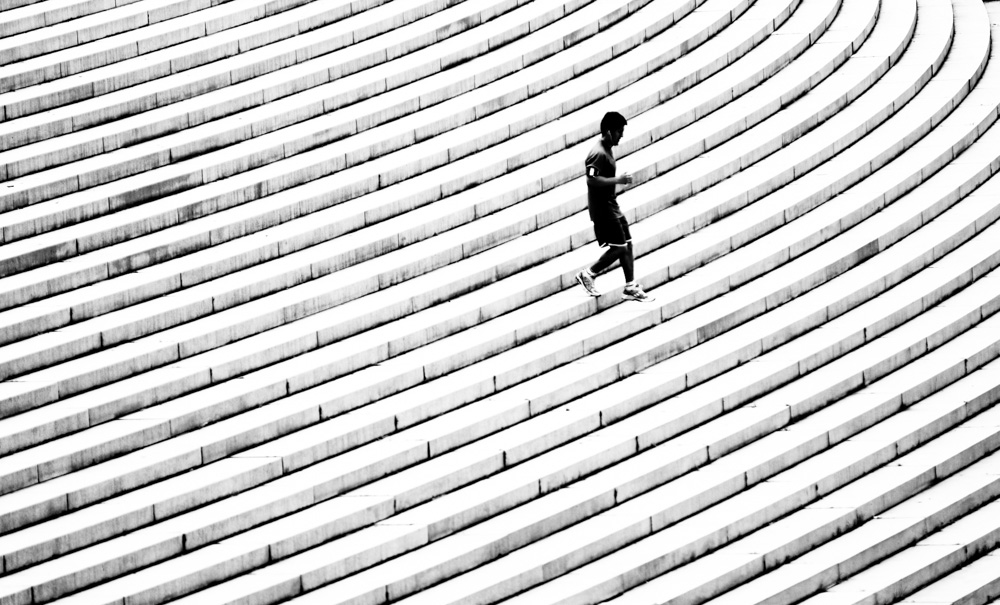Jogger at Margaret Bourke-White steps. Lincoln Memorial. Washington DC.