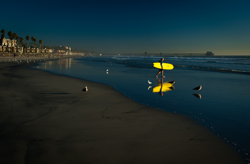 Surfing in Oceanside, CA. December 2013. Yellow surfboard.