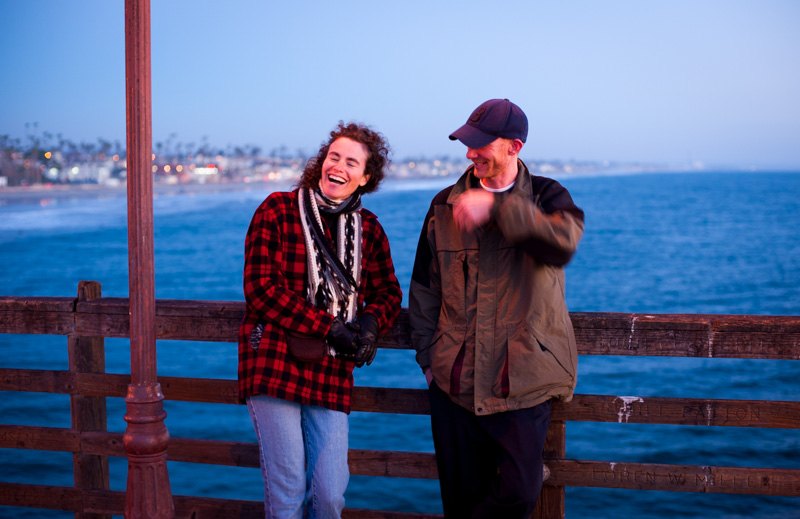 Woman and man laughing on the Oceanside pier in California.