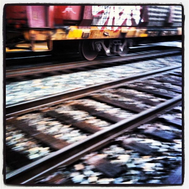 box car, moving fast along railroad tracks, blurred image