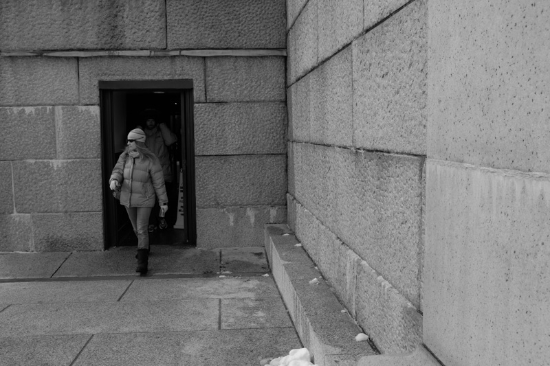 woman walking out of Lincoln Memorial visitor Center