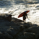 Jason Beakes climbing the rocks on the Potomac River at great Falls. Finlandia Vodka video shoot.