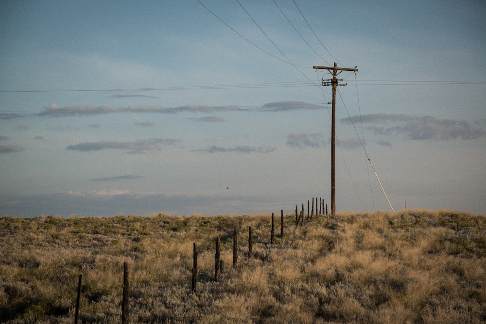 prairie scene. electrical lines and fence posts. monte vista, Colorado