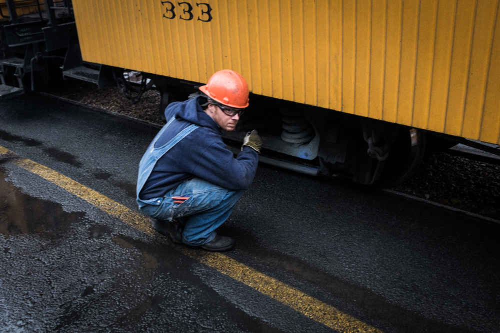 railroad worker with hardhat in durango, colorado. narrow gauge.