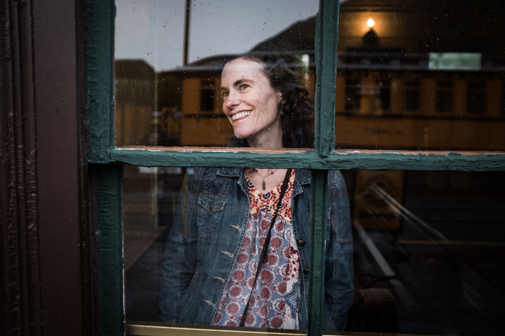 durango, colorado. woman in train station window on a rainy afternoon.
