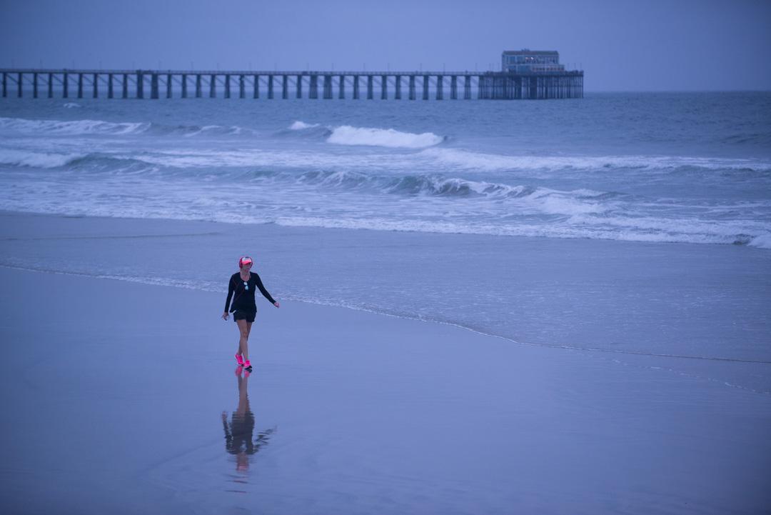 beach comber on oceanside beach. Oceanside, ca. early morning.