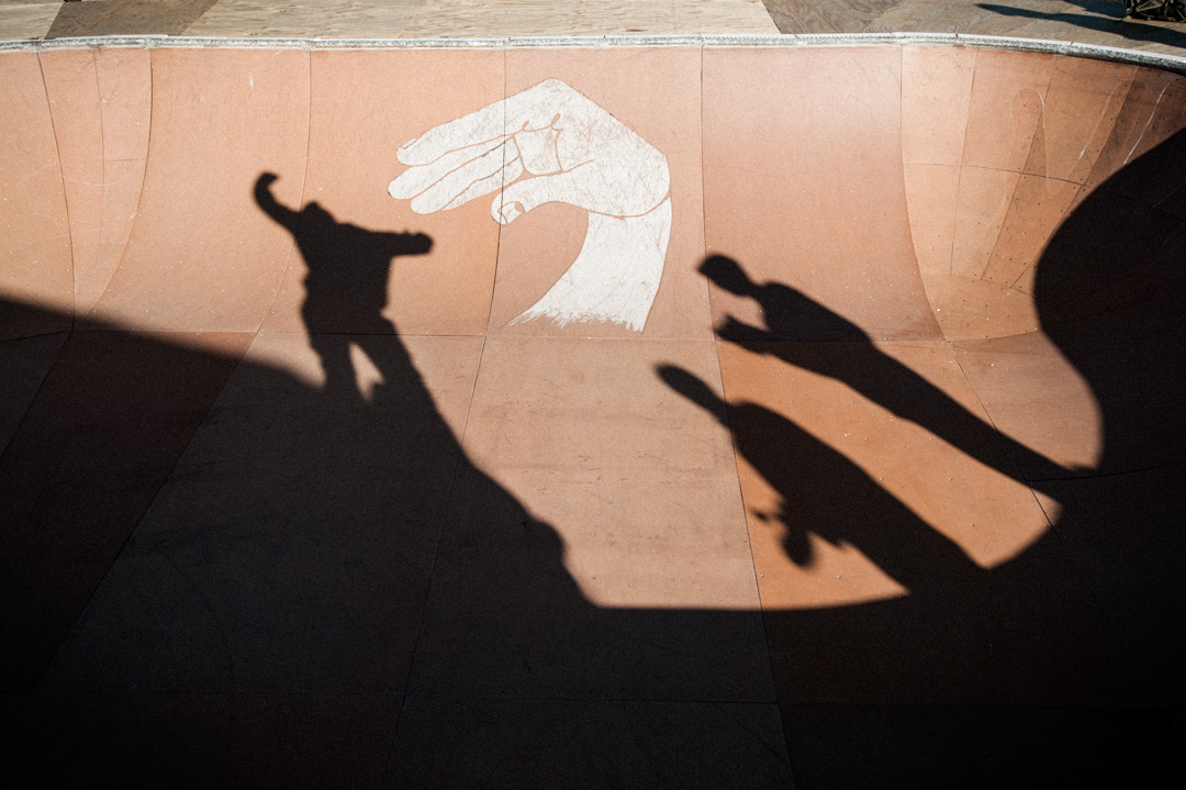 finding a line. shadows of skaters in skate bowl.