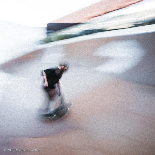 Skater in motion. Slow shutter speed blur.
