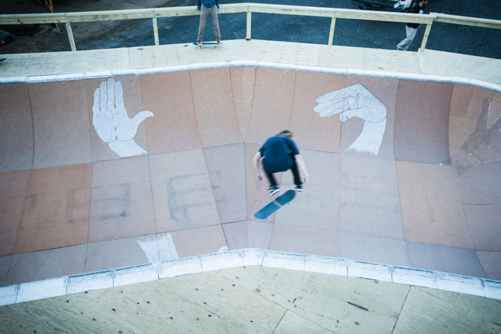 finding a line skate bowl. aerial view of skateboarder getting some air.