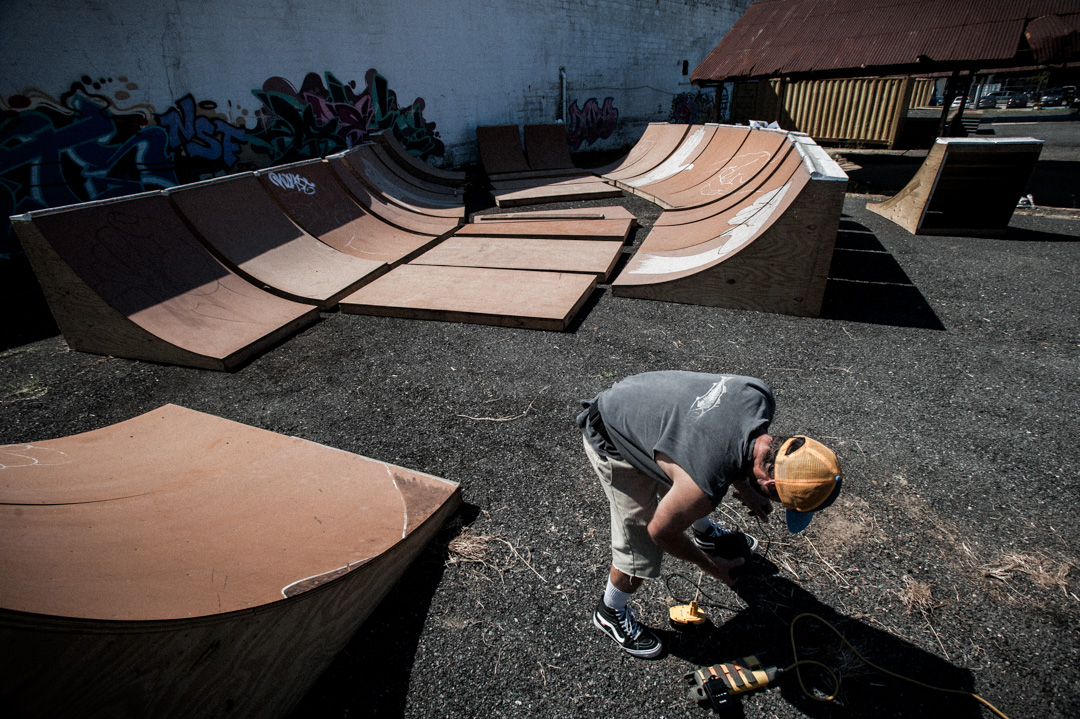 Ben Ashworth building a skate bowl in abandon lot near Union Market, DC.