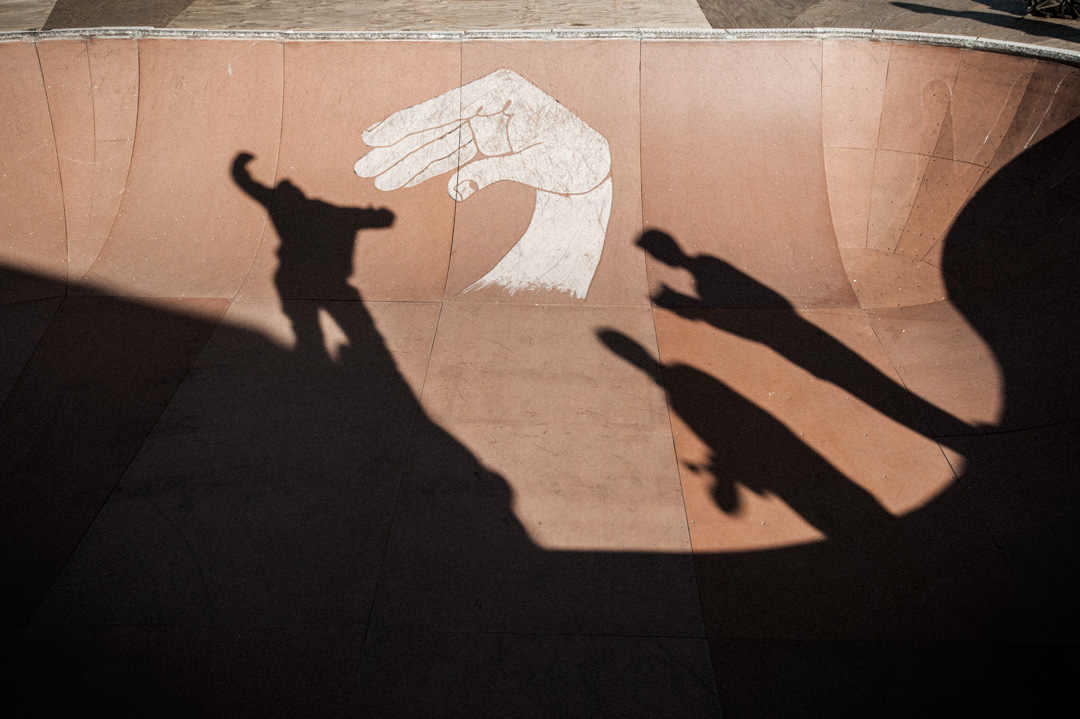 Shadows of skaters at the Finding A Line Bowl behind Union Market.