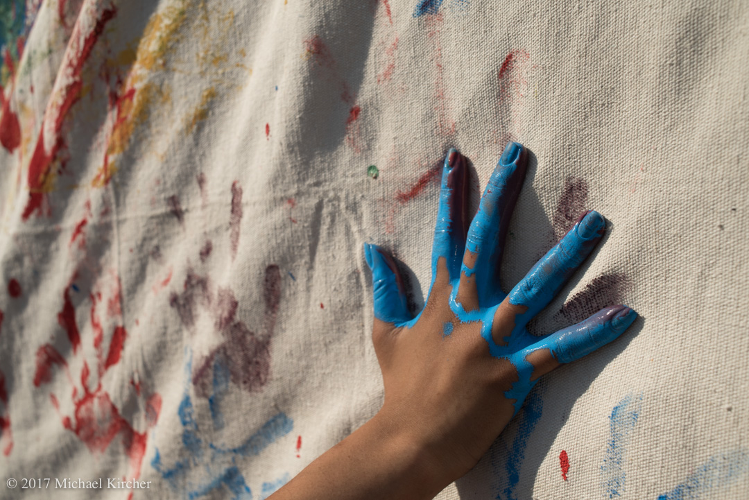 finding a line. hand painting with blue paint.
