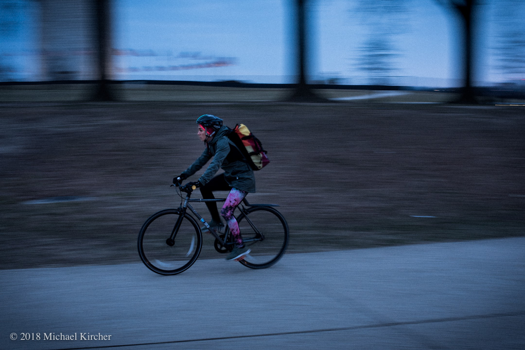 The subway isn't the only way to commute in Washington DC. A bicyclist zips by on her way home from work.