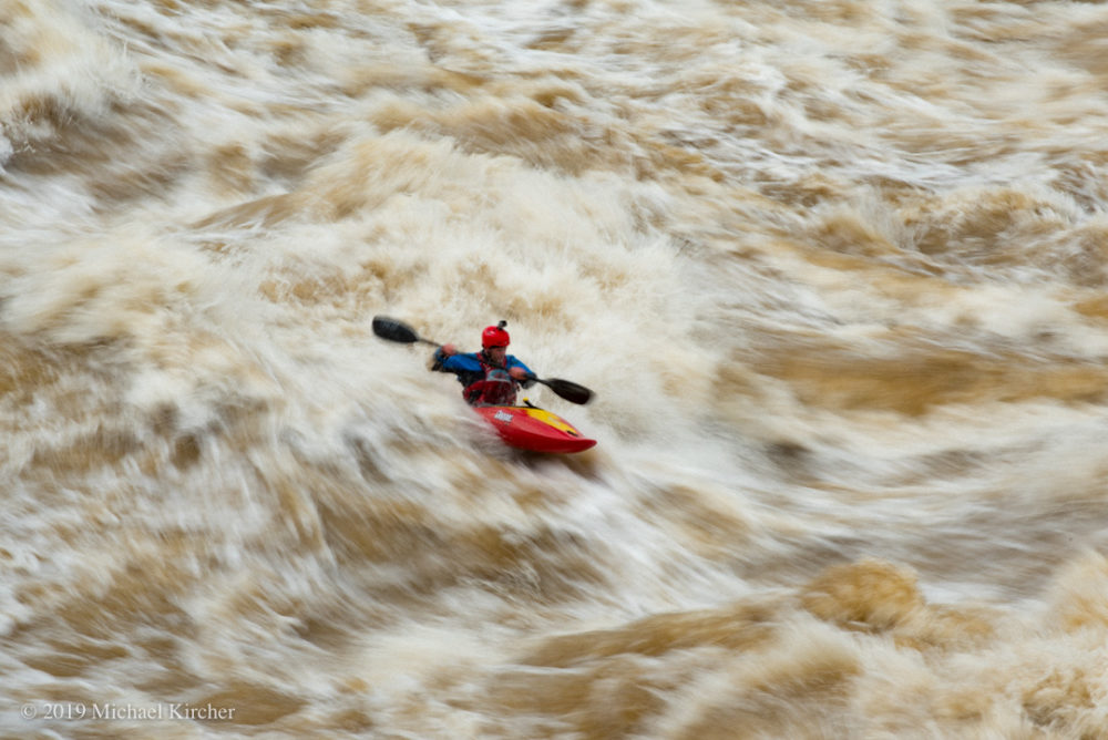 Whitewater kayaker, Geoff Calhoun. Thunder Hole wave below O-deck.